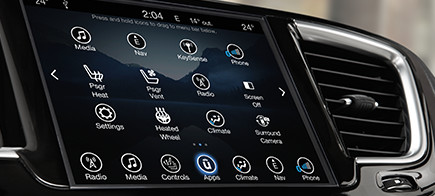 Car touch screen display showing the apps screen.