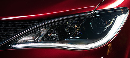 Front LED lights on a red car.