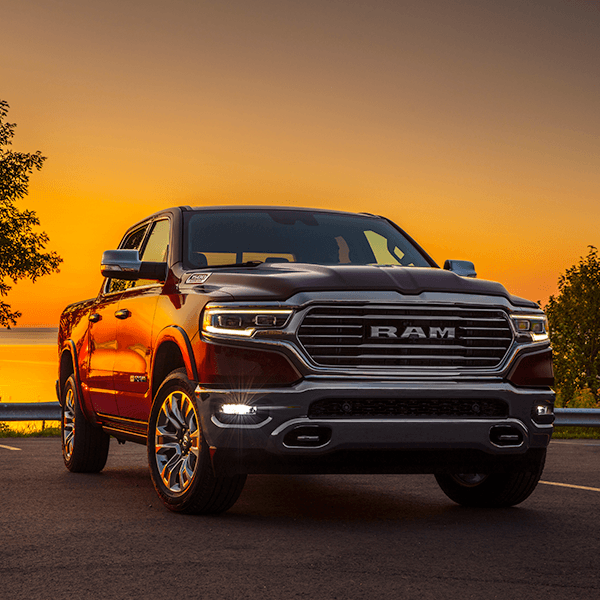 Rear quarter view of the All-New 2019 Ram 1500 parked outdoors on a hill