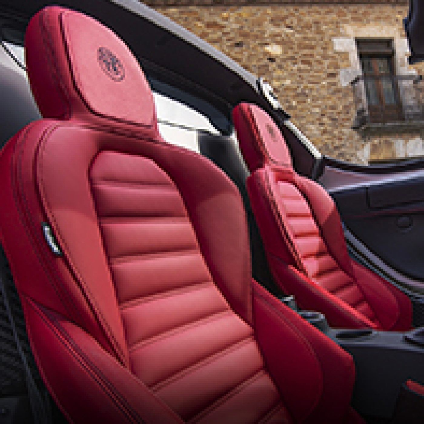 Side view of the red leather front seats of the 2019 Alfa Romeo 4C Spider