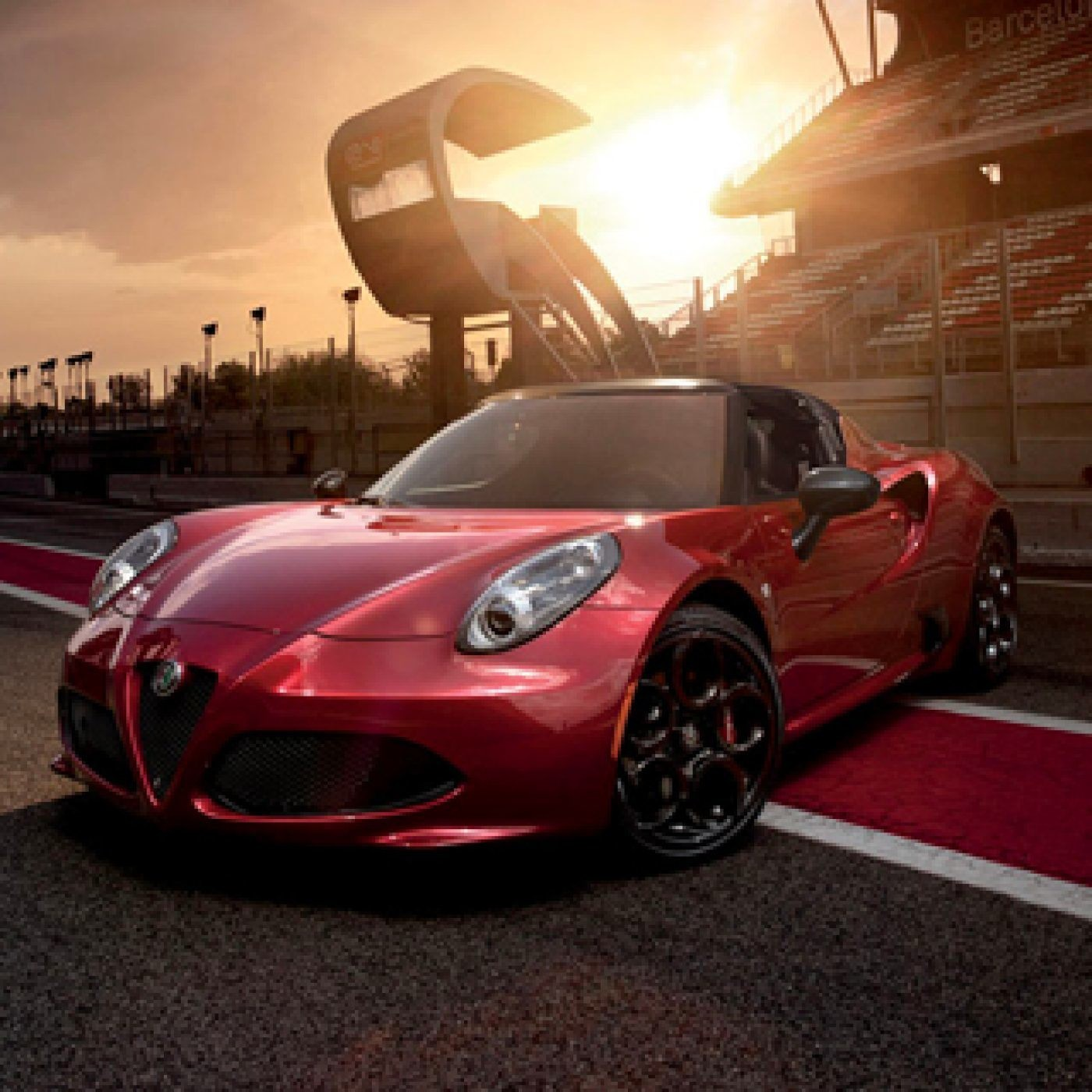Front view of the red 2019 Alfa Romeo 4C Spider parked on a race track