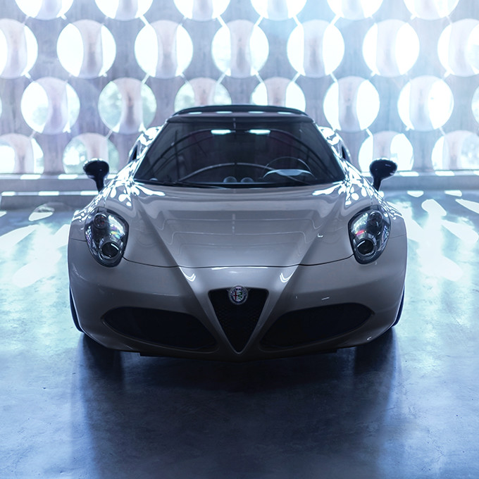 The front of the 2020 Alfa Romeo 4C Spider focusing on the hood, grille and headlamps.