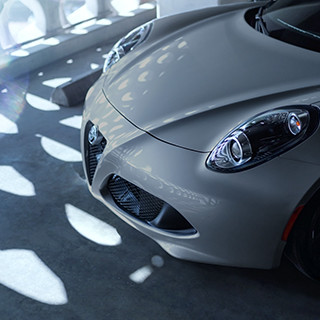 A raised view of the hood and projector headlamps on the 2020 Alfa Romeo 4C Spider.