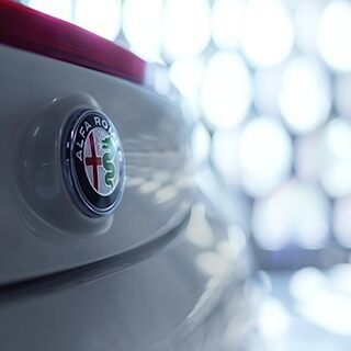 A close-up of the Alfa Romeo badge on the 2020 Alfa Romeo 4C Spider.
