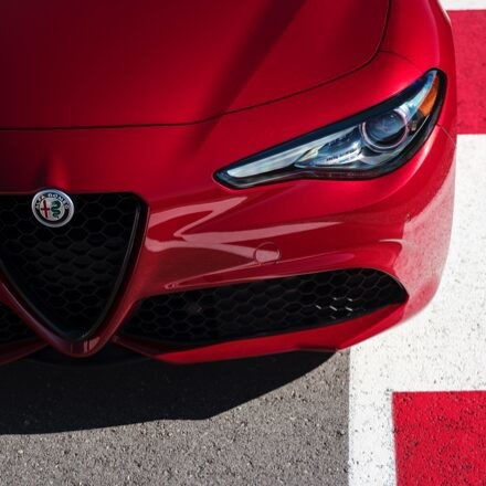A close-up of the grille, headlamp, lower fascia and hood on the 2020 Alfa Romeo Giulia.