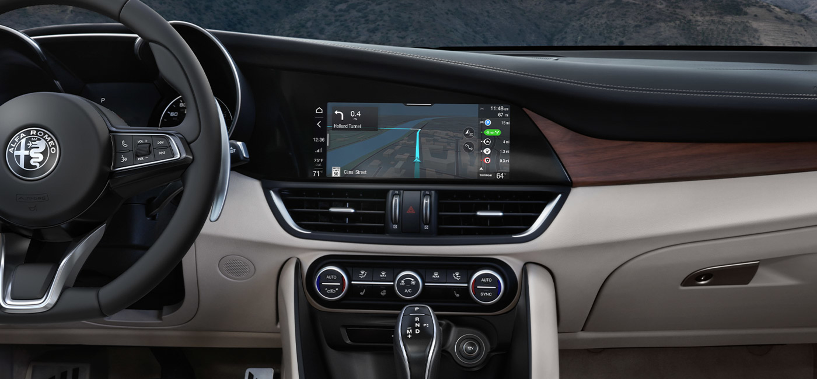 A close-up of the 8.8-inch touchscreen integrated into the dash of the Alfa Romeo Giulia.