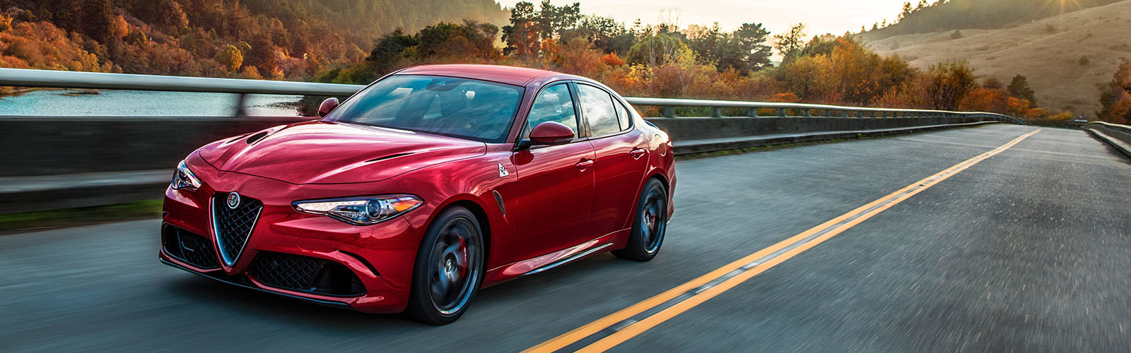 A red 2020 Alfa Romeo Giulia being driven down the road