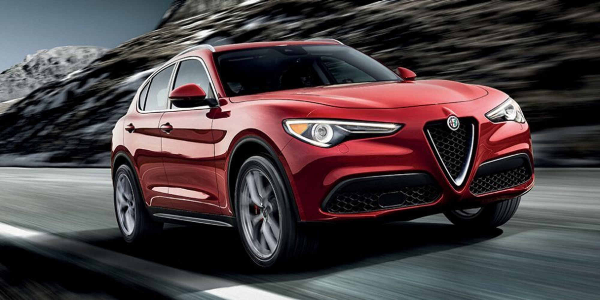 2018 Alfa Romeo Stelvio Running Shot Front Side View