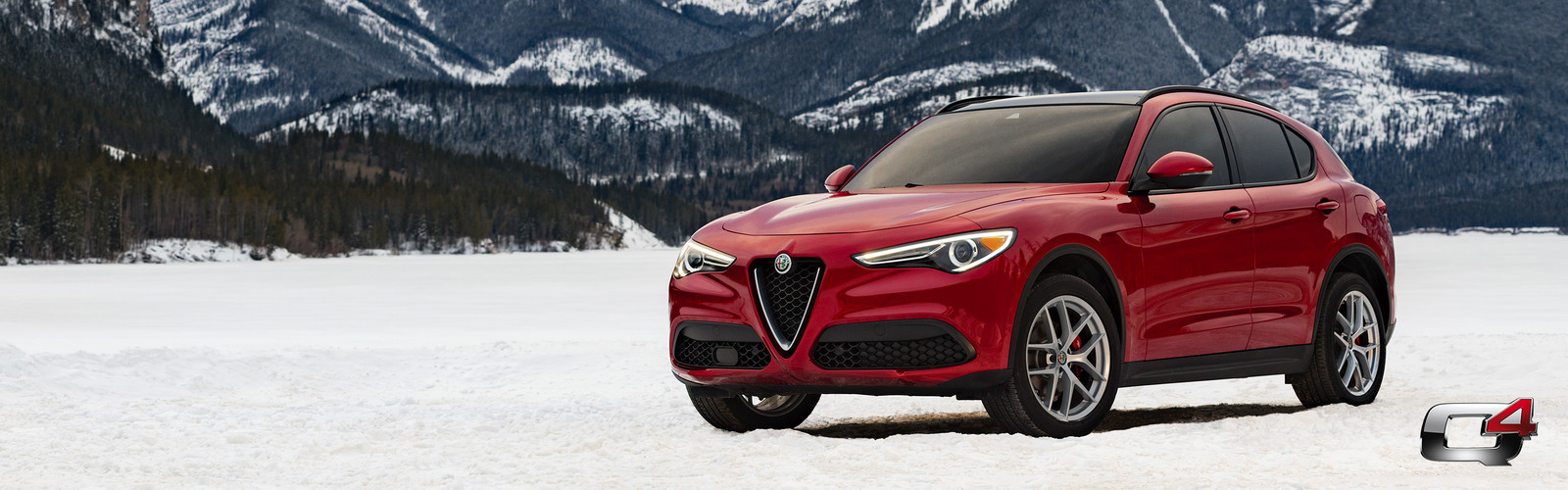 Front view of the red 2019 Alfa Romeo Stelvio parked in the mountains