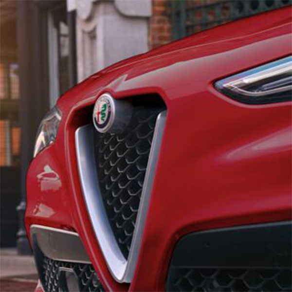 A close-up of the grille and Alfa Romeo badge on the 2020 Alfa Romeo Stelvio.
