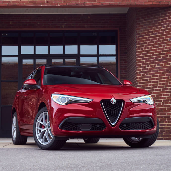 The 2020 Alfa Romeo Stelvio being driven through the woods.