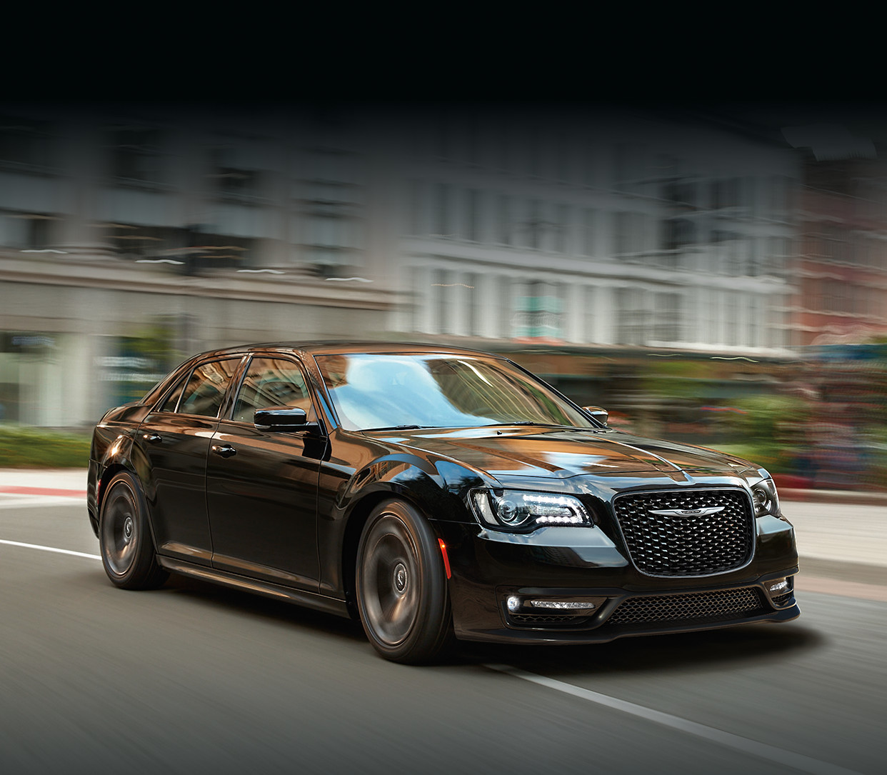 2019 Chrysler 300 driving down city street