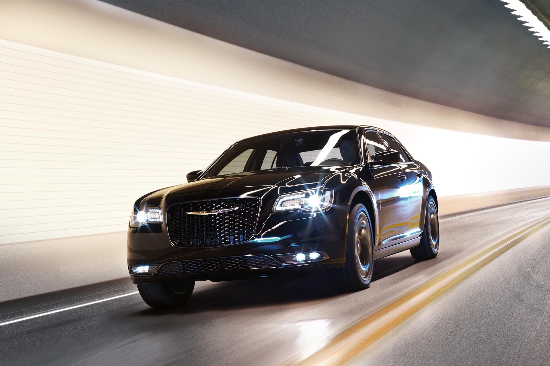 The black 2020 Chrysler 300 driving through a tunnel