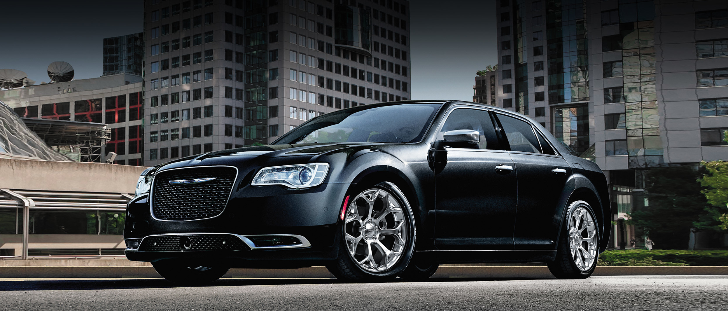 The black 2020 Chrysler 300 parked on a road in urban area