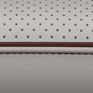 Nappa leather-faced with perforated inserts and ventilated fronts – Alloy with Cranberry Wine accent piping and stitching