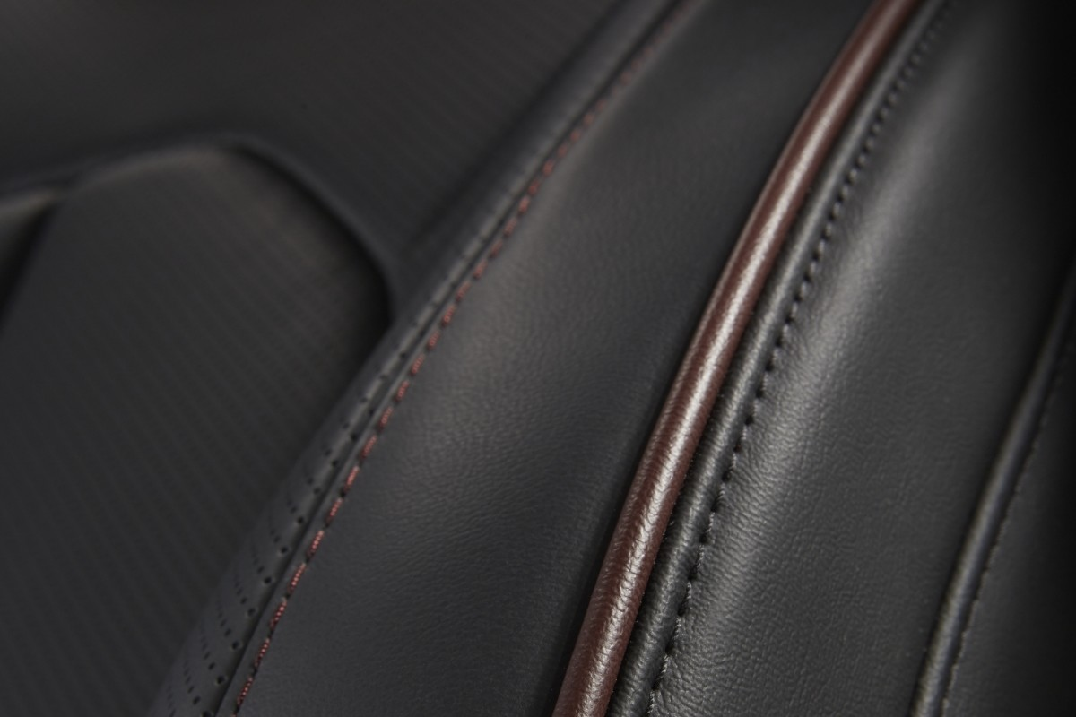 2020 Chrysler Pacifica showing a close up of the leather seating with cranberry wine stitching