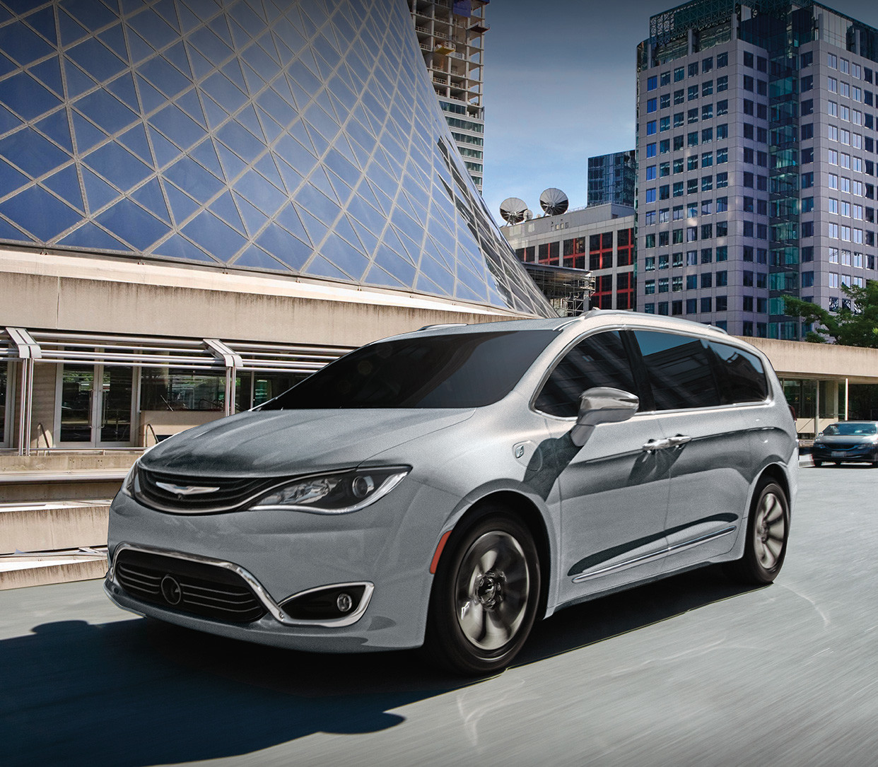 Silver Chrysler Pacifica Driving Through the City