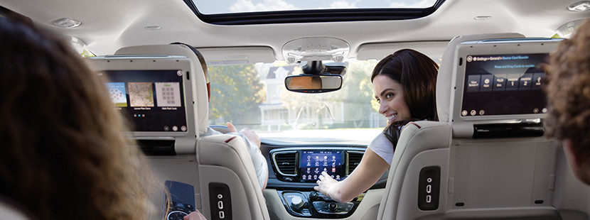 2019 Chrysler Pacifica woman using entertainment system