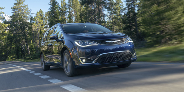 Blue 2020 Chrysler Pacifica being driven fast on the road