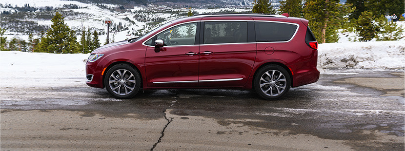 Side view of the red 2020 Chrysler Pacifica parked on the side of a snowy mountain