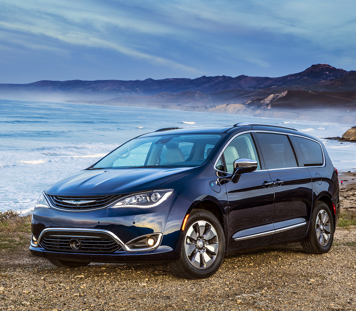 Blue Chrysler Pacifica Hybrid Speeding Through the Plains