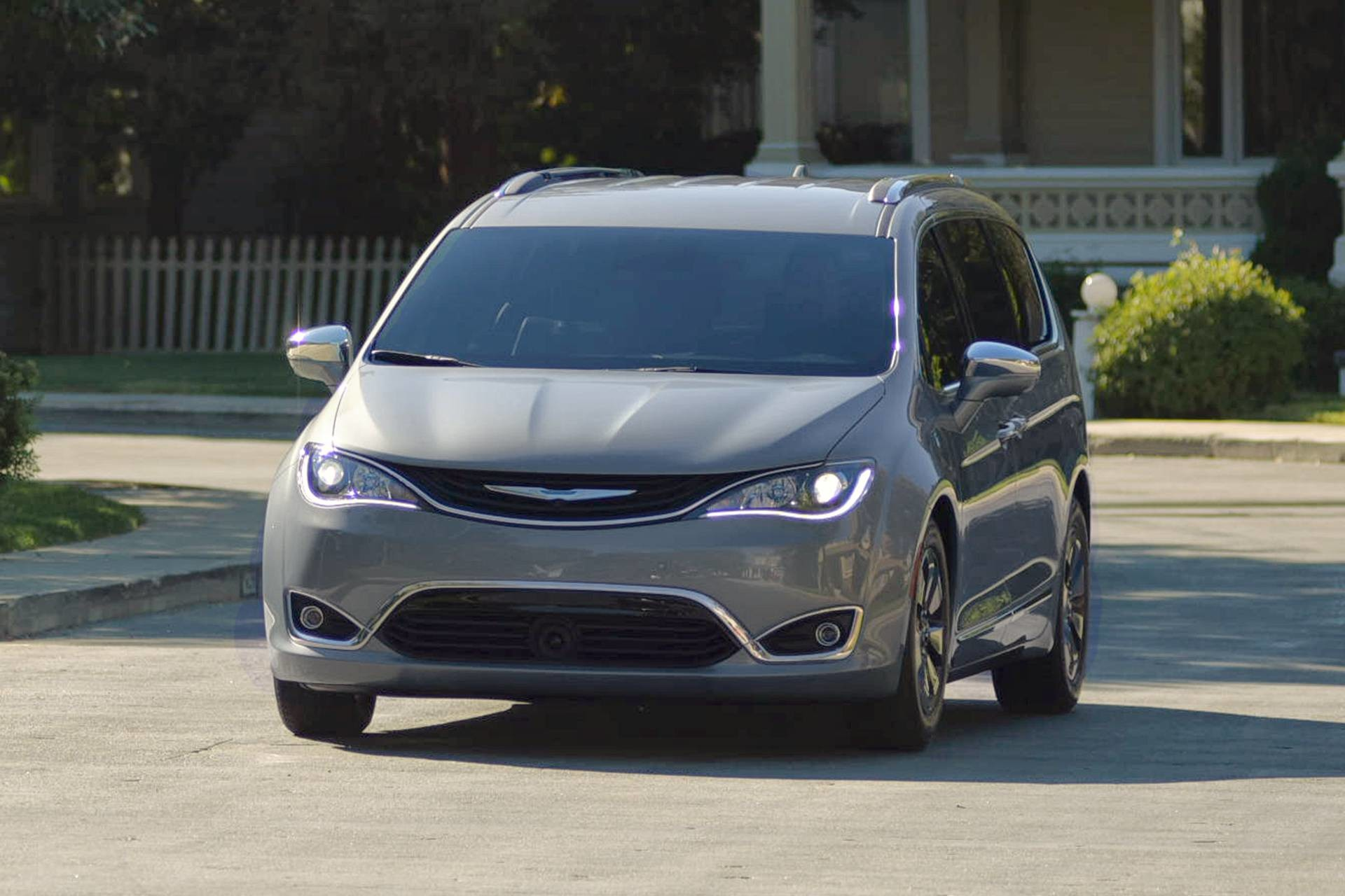 2019 Chrysler Pacifica Hybrid exterior view on residential street, shown in silver