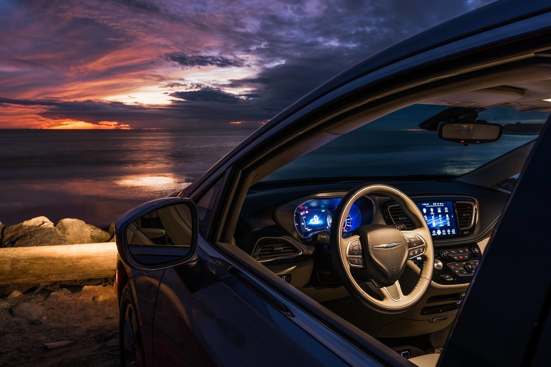 2019 Chrysler Pacifica Hybrid interior showing 7-inch full-colour in-cluster display and Uconnect NAV