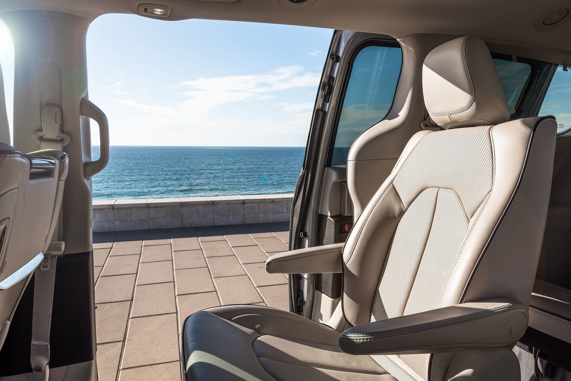 2019 Chrysler Pacifica Hybrid interior showing 2nd-row bucket seats and power sliding doors