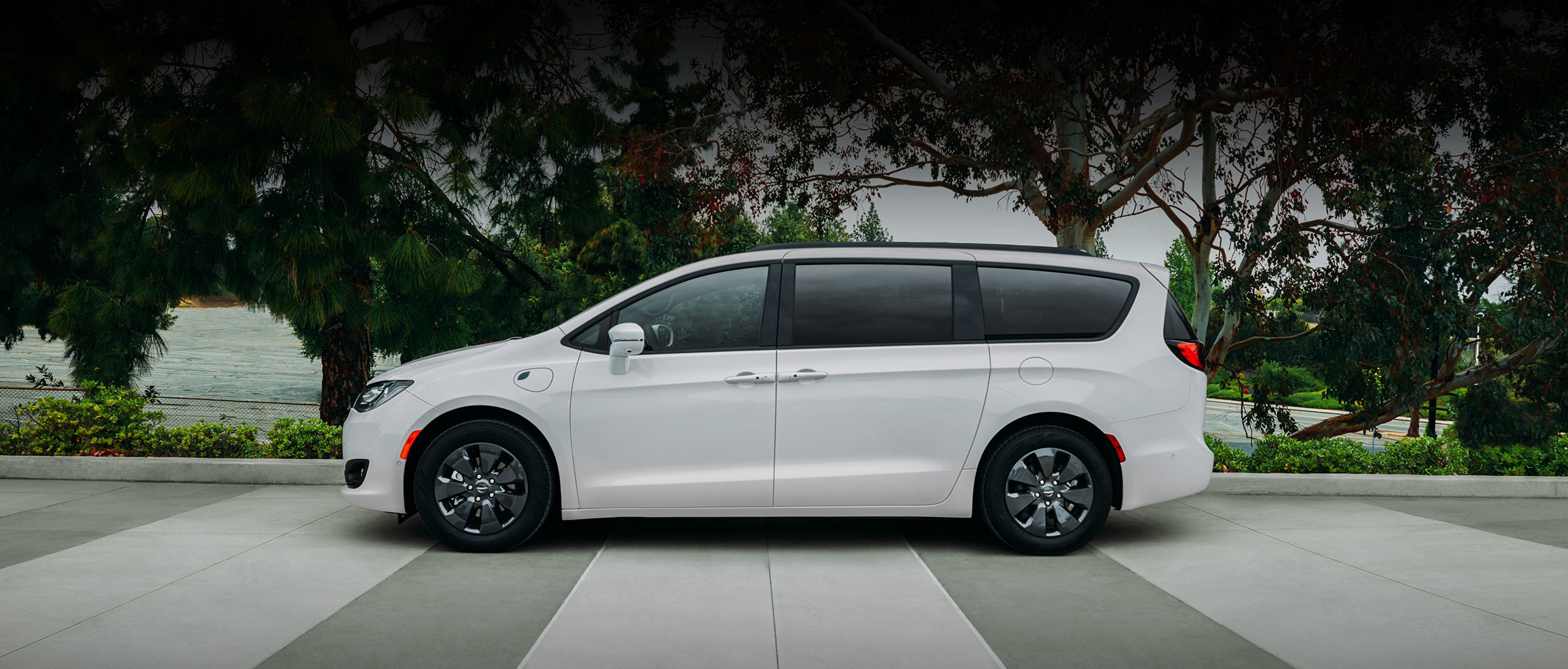 Side view of a parked white 2020 Pacifica Hybrid