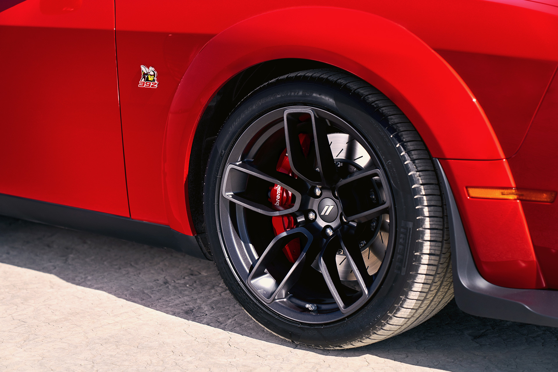2019 Dodge Challenger in red showing 20-inch aluminum wheels