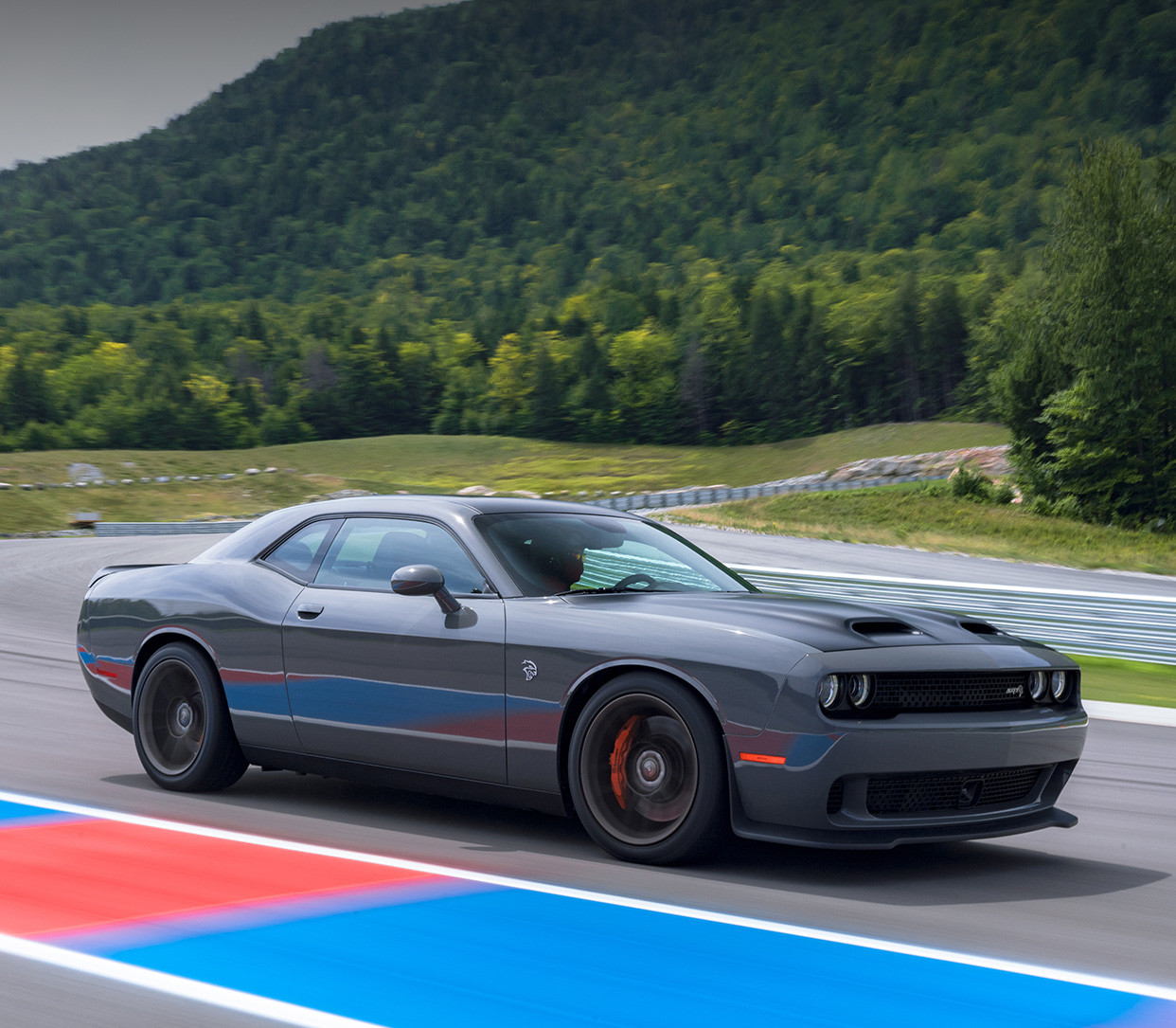 Grey 2019 Dodge Challenger being driven on an outdoor racing track.
