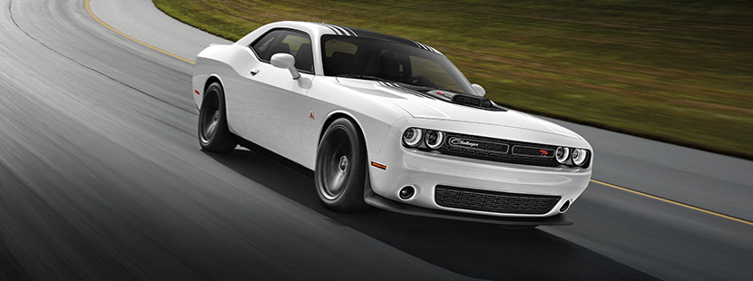 White 2019 Dodge Challenger being driven around a race track.