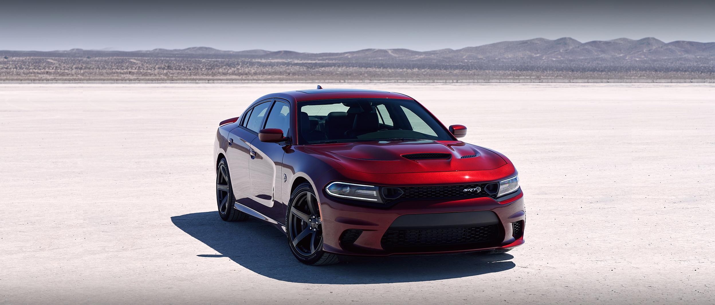 Red Dodge Charger Parked in the Middle of the Desert