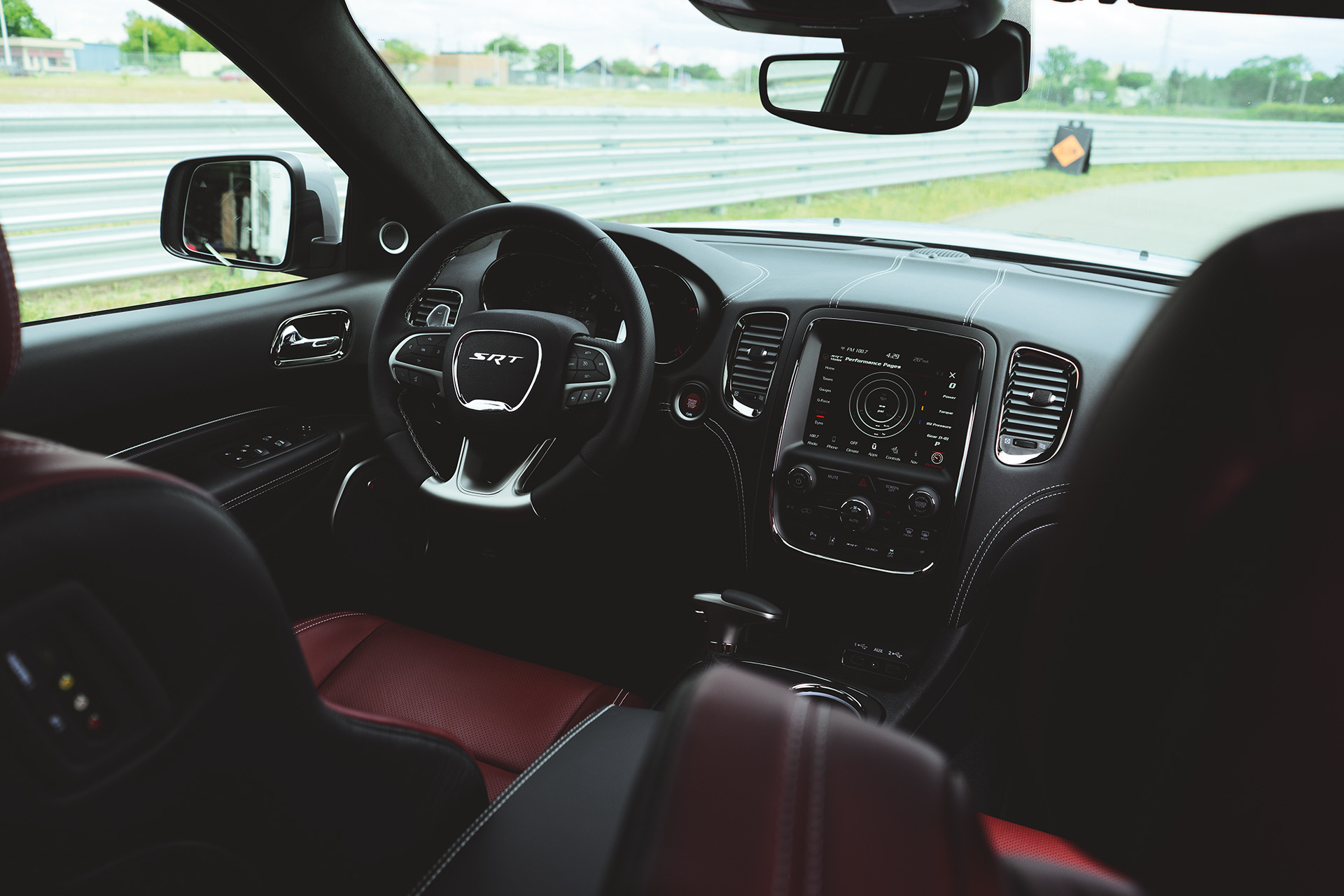 2019 Dodge Durango interior view of SRT cockpit, showing steering wheel and full-colour in-cluster display
