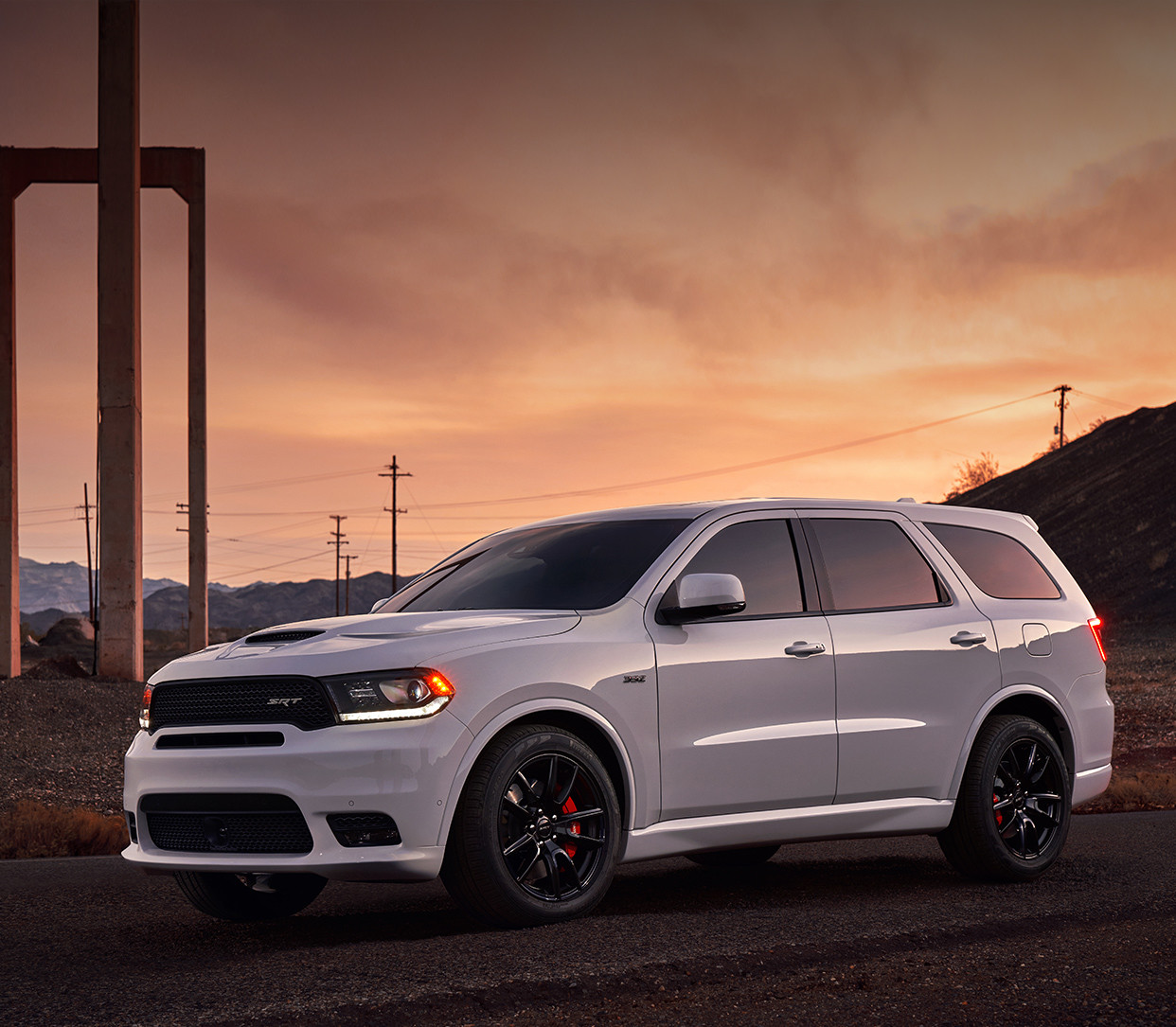 White 2019 Dodge Durango, parked on a paved road in a suburban area.