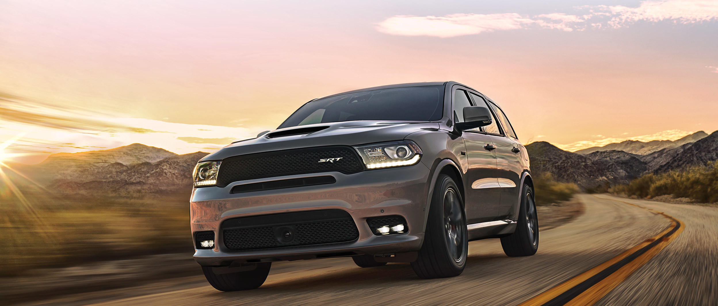 Grey 2020 Dodge Durango being driven on a freeway through mountains.