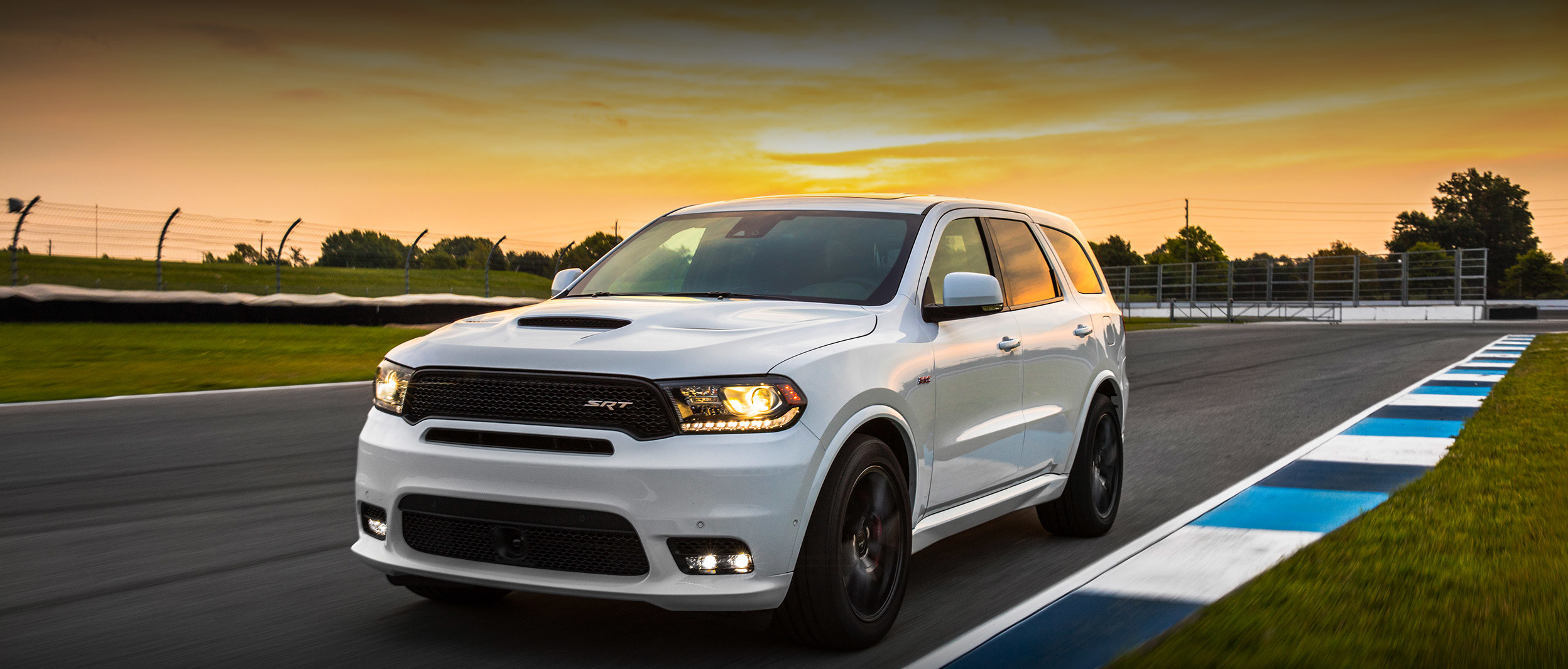 White 2020 Dodge Durango being driven on a race track