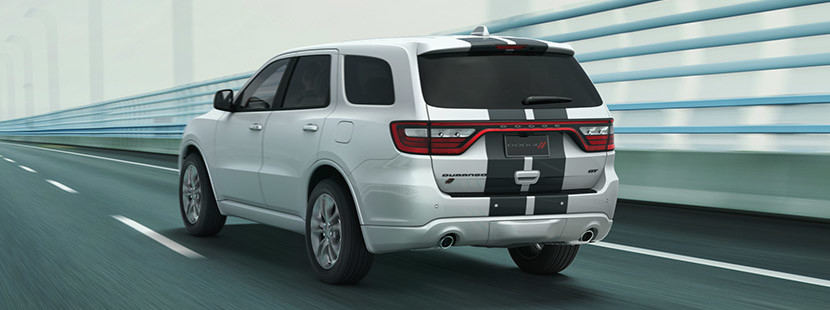 Rear view of the white 2020 Dodge Durango driving down a highway