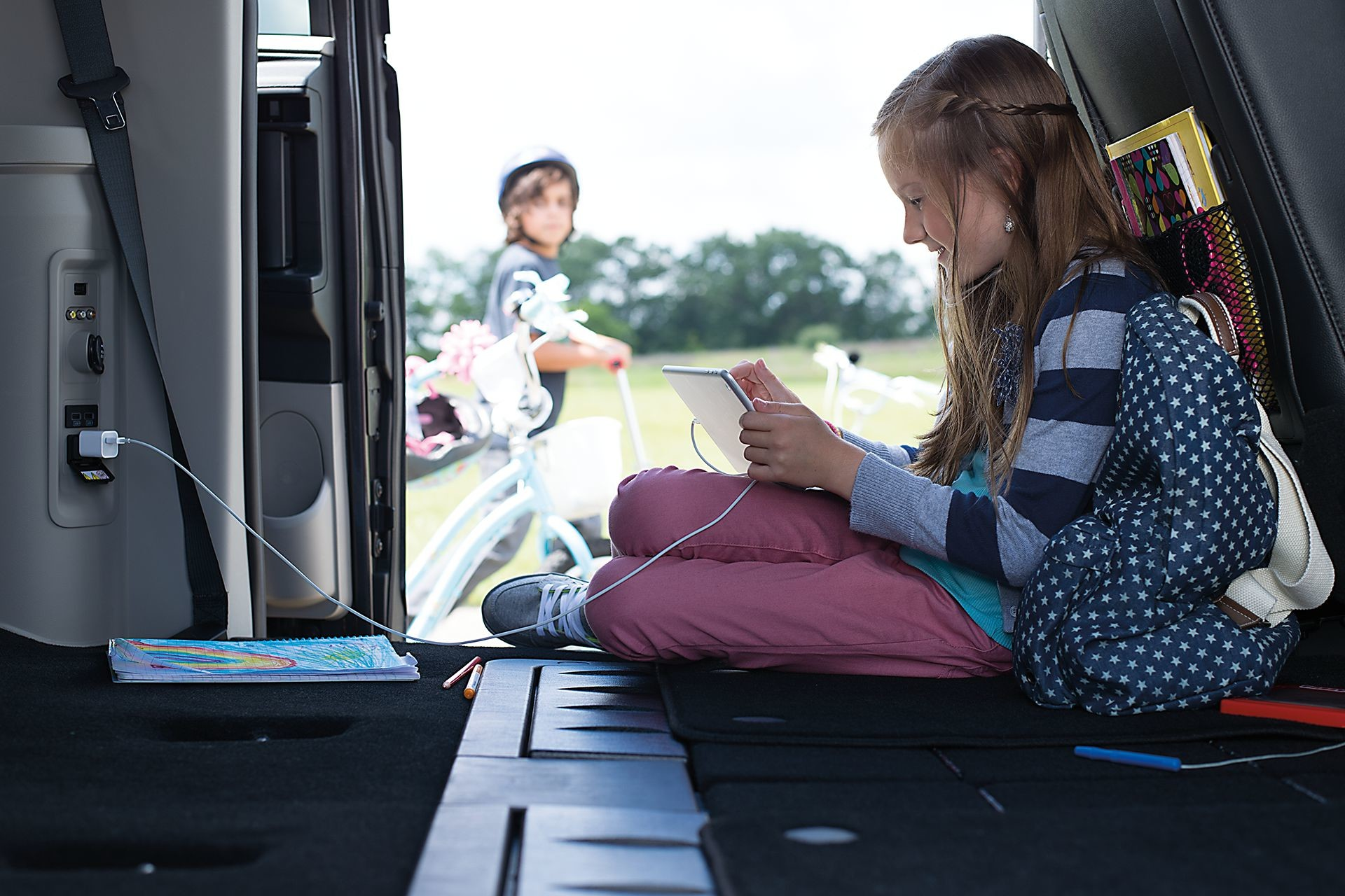 2019 Dodge Grand Caravan interior view of child charging a device