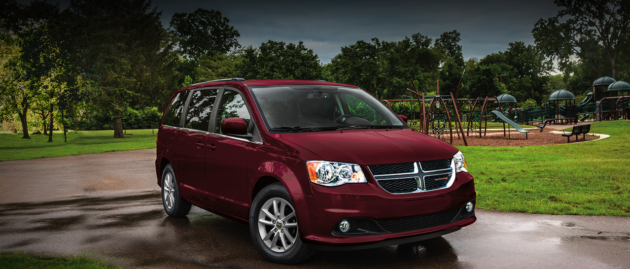 Front view of a red 2020 Dodge Grand Caravan parked in a driveway