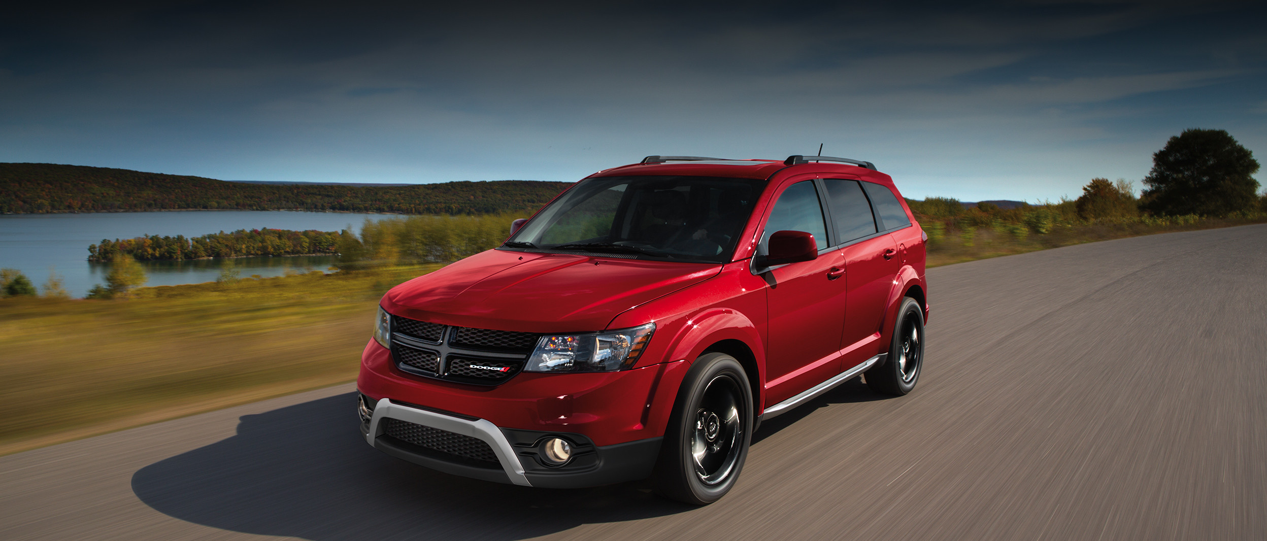 Front view of the grey 2020 Dodge Journey Crossroad driving on a road