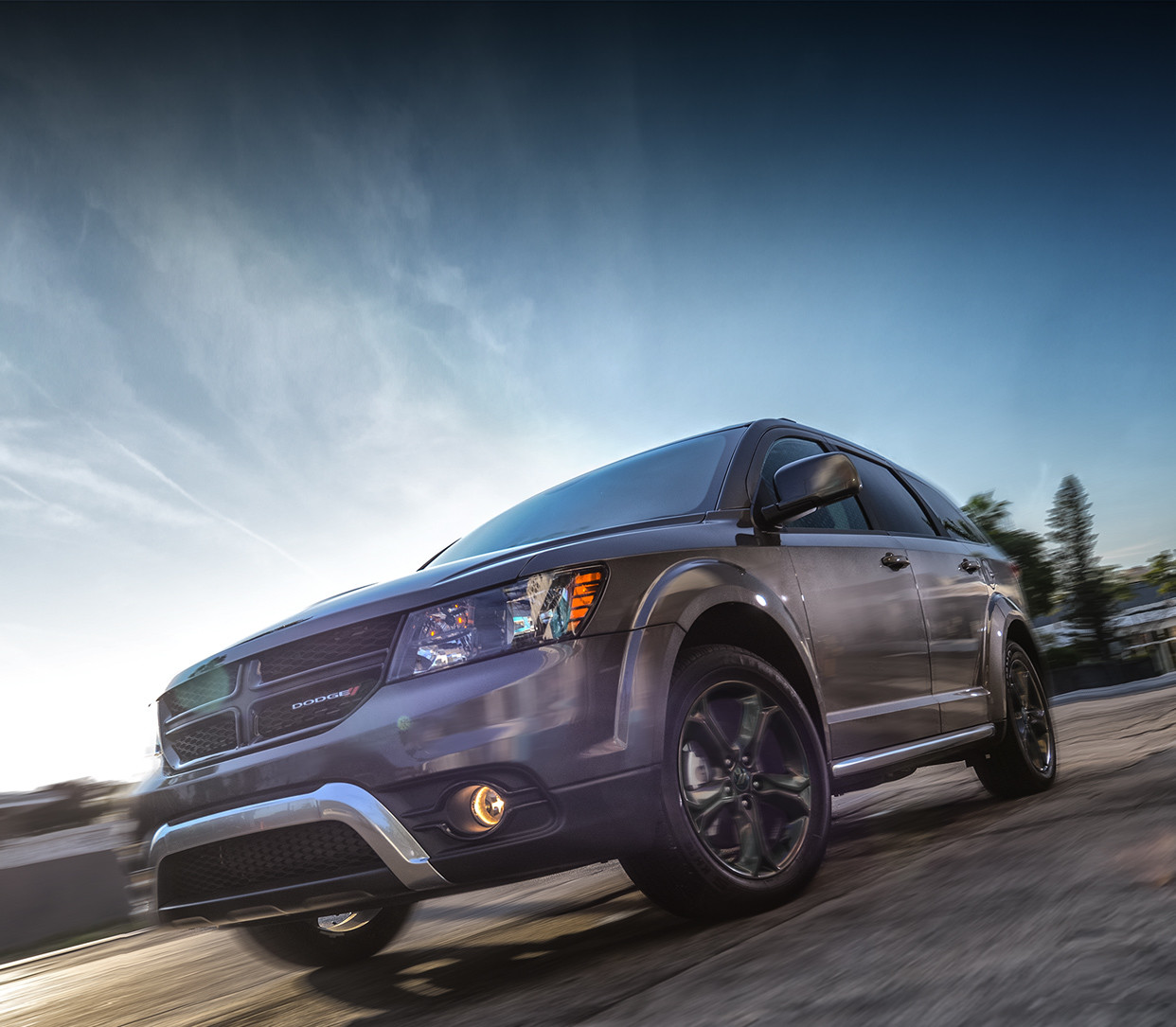 Front view of the red 2020 Dodge Journey driving on a country road