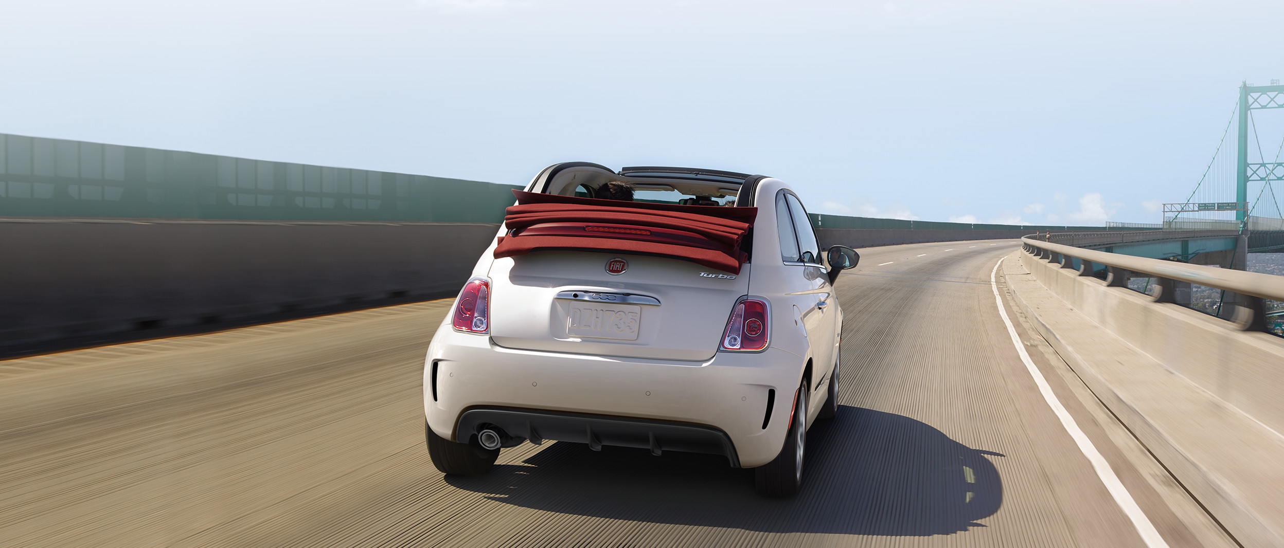 2018 Fiat 500 rear profile with retractable soft top in white