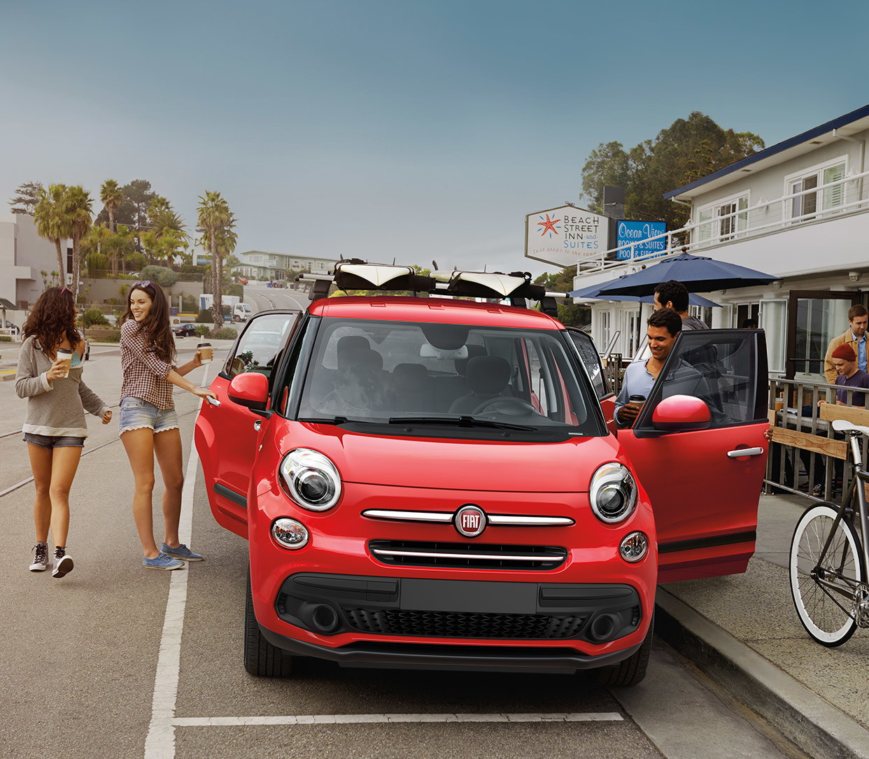2019 Fiat 500L parked on a city street, shown in red