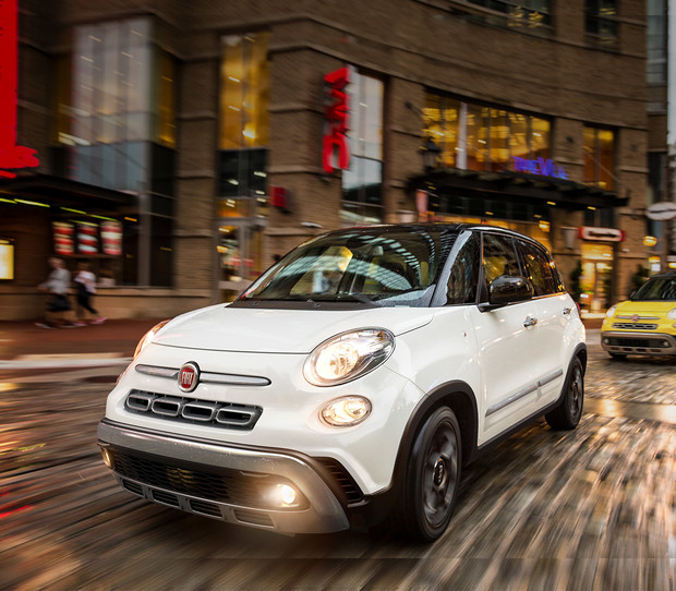2019 Fiat 500L driving down a city street, shown in white and yellow