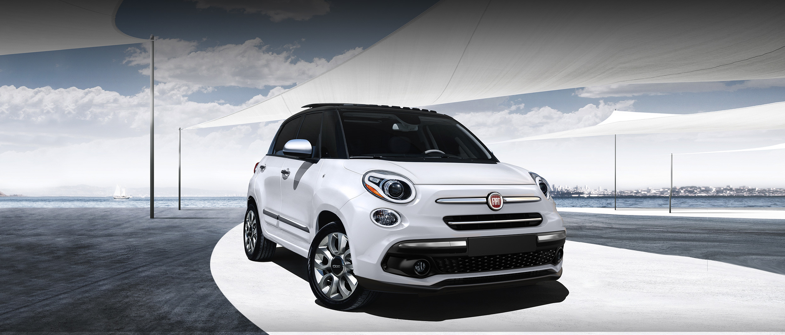 The 2020 Fiat 500L parked in an outdoor parking lot