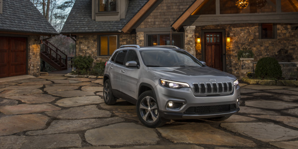 Grey 2021 Jeep Cherokee parked on the driveway of a cottage home