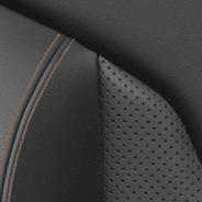 Leather-faced seats with perforated inserts - Black with Cattle Tan accent stitching and embossed Jeep<sub>®</sub> logo