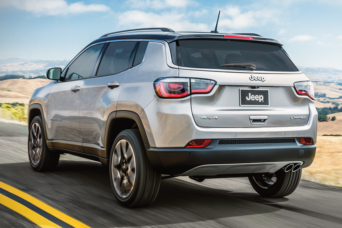 2019 Jeep Compass driving down highway
