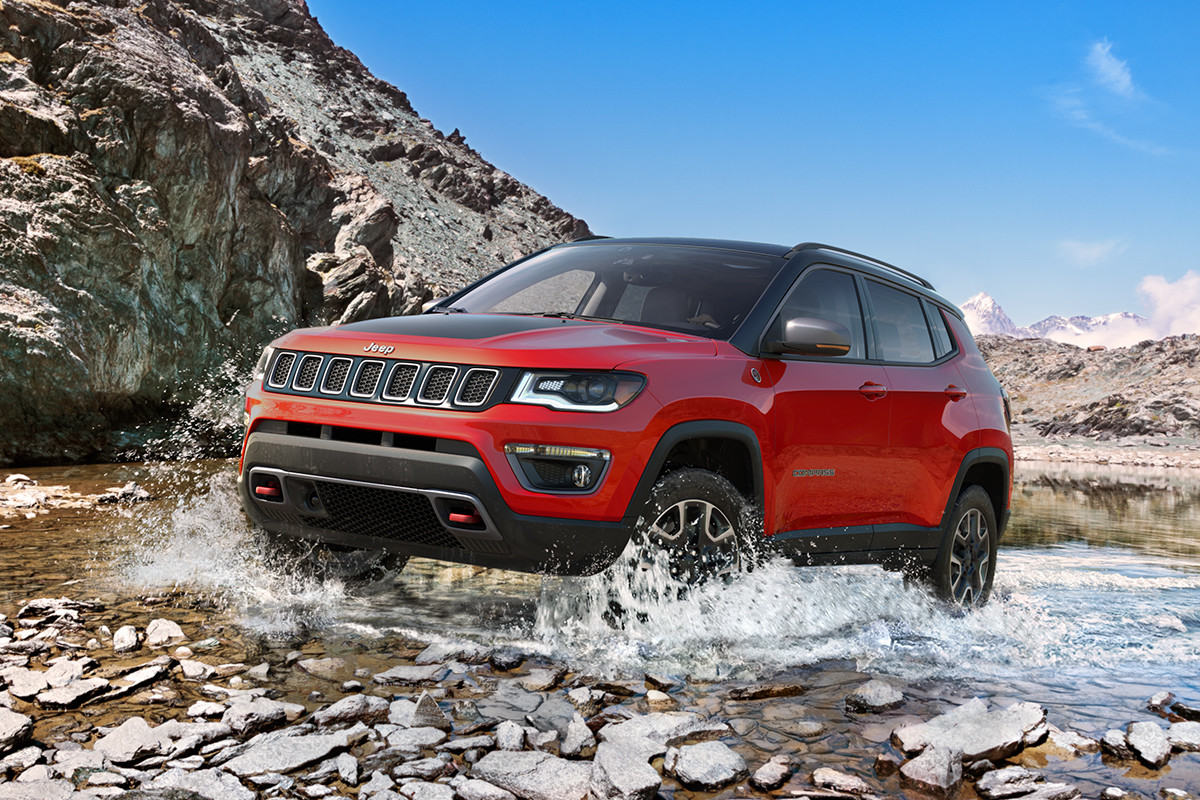 2019 Jeep Compass off-roading in a forest